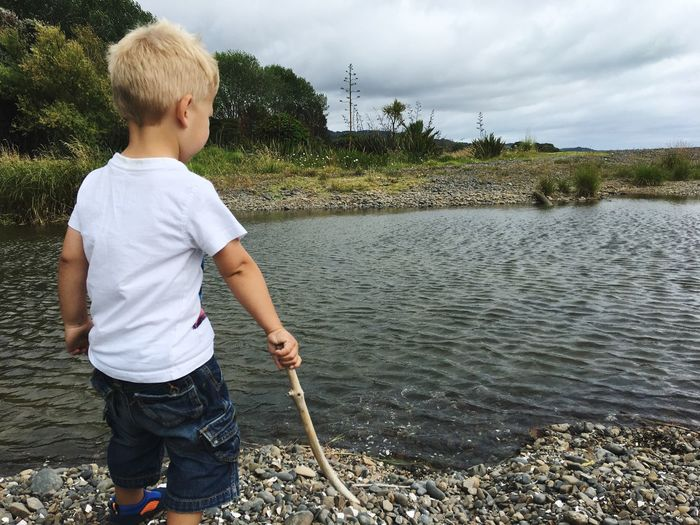 Boy and water EyeEm Selects Boys Childhood One Person Real People Water Leisure Activity Outdoors Casual Clothing Standing One Boy Only