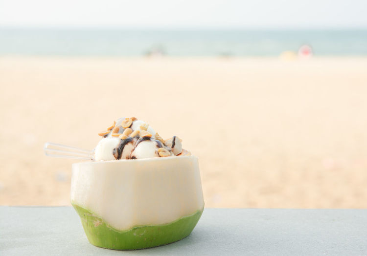 Close-up of ice cream on beach