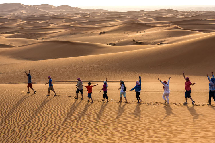Group of people on sand dune