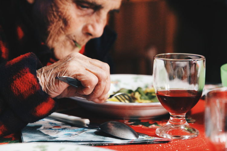 Eating Old People, Woman Food And Drink Wineglass Wine Only Men Alcohol Adults Only Adult One Person Drink Table People Red Wine Mid Adult Drinking Drinking Glass Indoors  Sitting Close-up Food Stories