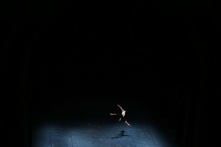 Shirtless Man Performing Ballet Dance On Stage