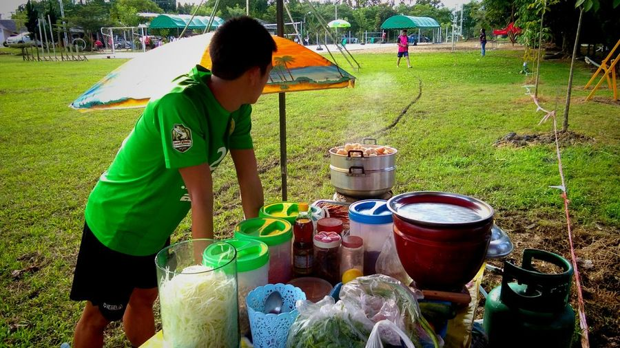 Street foods (meatball,Smoothies,papaya salad) Green Chaingrai Thailand Country House Country Life Country Living Chiang Rai, Thailand Street Food Market Streed Food Streedfoodmarket Food And Drink Market Papaya Salad Working Occupation Agriculture Spraying Men Vegetable Green Color