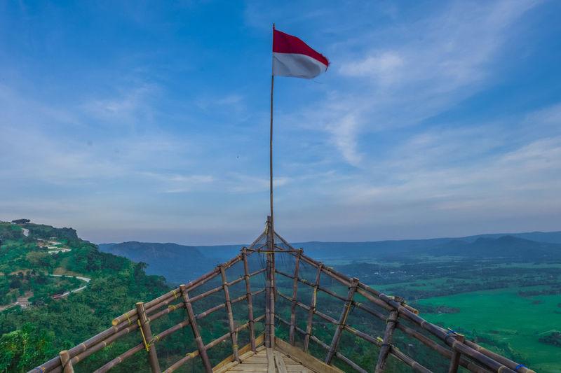 Flag on landscape against sky