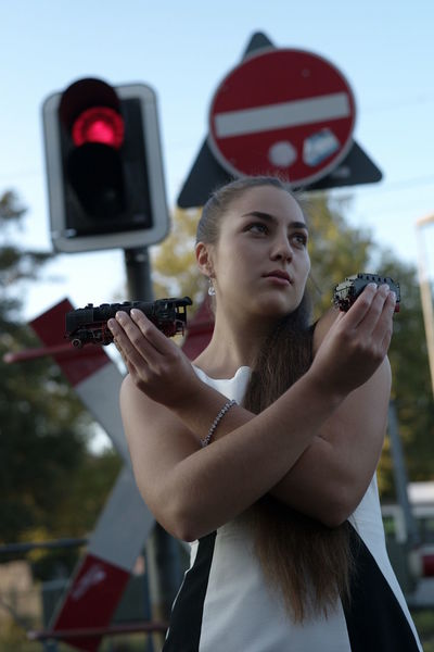 X Beauty Day Focus On Foreground Holding Holding Toy Leica Leica M8.2 Lifestyles Locomotive Locomotive Model Looking Sideways One Person Ponytail Portrait Portrait Young Woman Railroad Crossing Railroad Track Real People Sky Summer Dress ❤️ Technology Toy Locomotive Young Adult Young Woman Young Women