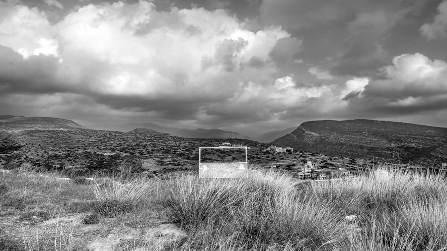 Cloud - Sky Sky Land Grass Landscape Scenics - Nature Plant Field Beauty In Nature Architecture Nature Tranquil Scene Tranquility Environment Built Structure No People Mountain Day Non-urban Scene Building Exterior Outdoors Blackandwhite Black And White EyeEm EyeEm Best Shots