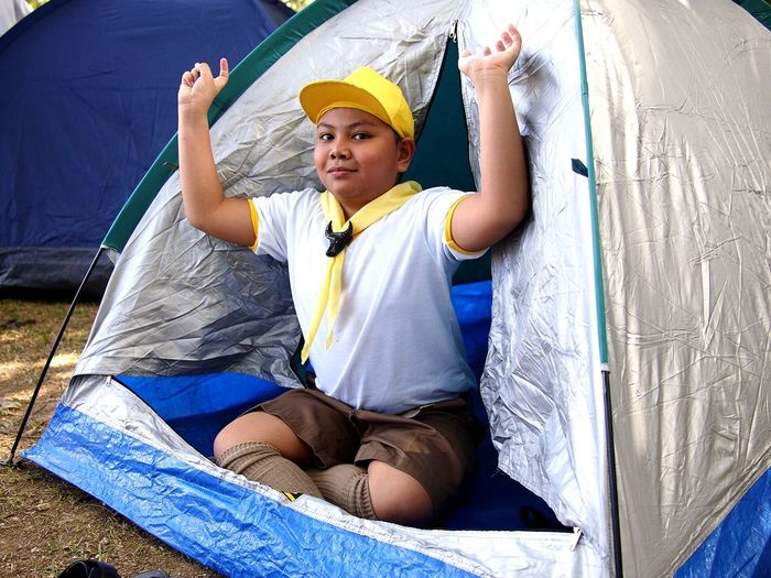 Portrait of boy sitting in tent