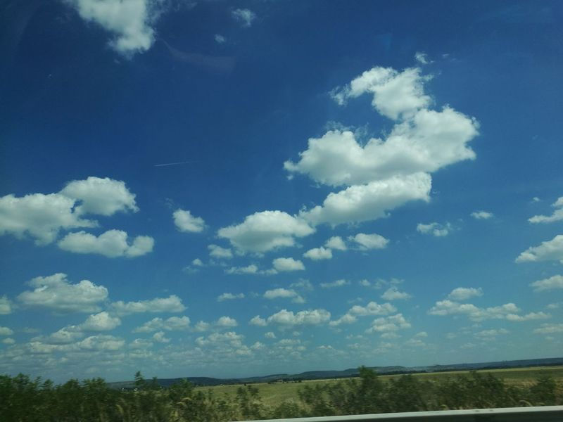 Beauty In Nature Blue Cloud Cloud - Sky Clouds And Sky Cloudy Day Field Grass Horizon Over Land Landscape Nature No People Non-urban Scene Outdoors Remote Rural Scene Sky