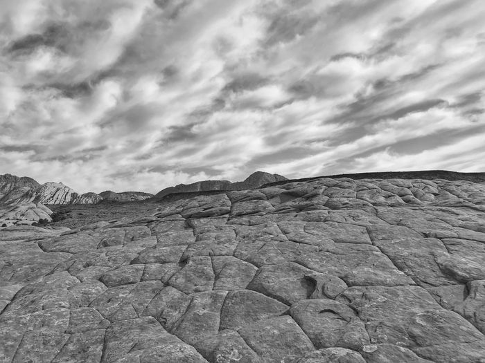 Black and white Low angle view of patterned rounded rock formation Snow Canyon State Park Black And White Cloud - Sky Sky Tranquility Scenics - Nature Tranquil Scene Landscape Nature Day No People Environment Land Beauty In Nature Solid Arid Climate Outdoors Rock Remote Climate Desert Non-urban Scene