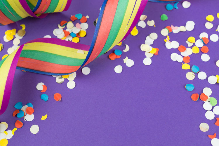 High Angle View Of Decorations On Violet Background