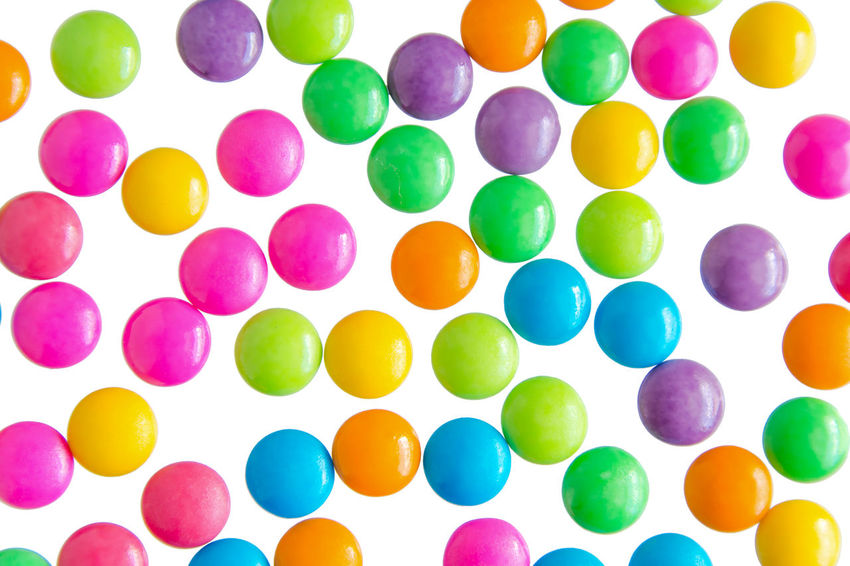Colorful chocolate coated candy isolated Chocolate Circle Isolated Pink Snack Sugar Blue Candy Clipping Path Coated Directly Above High Angle View Large Group Of Objects Multi Colored Multiple Orange Color Party Purple Red Color Shape Still Life Sweet Food White Background