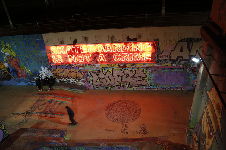 Western Script Illuminated Graffiti Communication Night Architecture Built Structure No People Building Exterior Wall - Building Feature Creativity Sign Art And Craft Multi Colored Lighting Equipment Outdoors Neon Low Angle View Glowing Message Mural Skateboarding Skate Skateboard Park Skate Park EyeEmNewHere Capture Tomorrow Moments Of Happiness Skate Photography: Same Tricks, New Perspectives Streetwise Photography