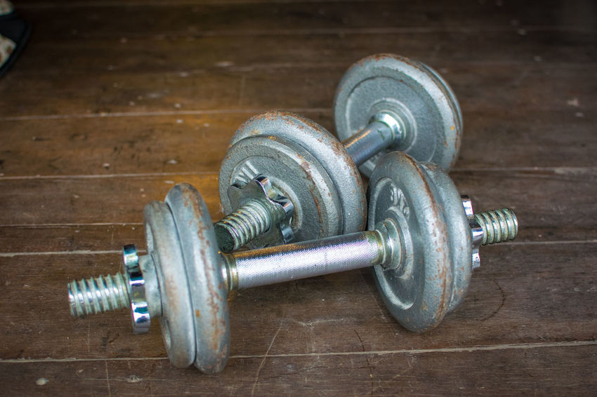 Metal dumbell on wood floor background Body & Fitness BodyBuilder Bodybuilding Exercise Iron Wood Aluminium Backdrop Background Close-up Color Colour Day Dumbbell Exercise Equipment Exercising Fit Fitness Floor Gym Health Health Club Healthy In Door Indoors  Kilo Metal No People Old Wood Sport Strength