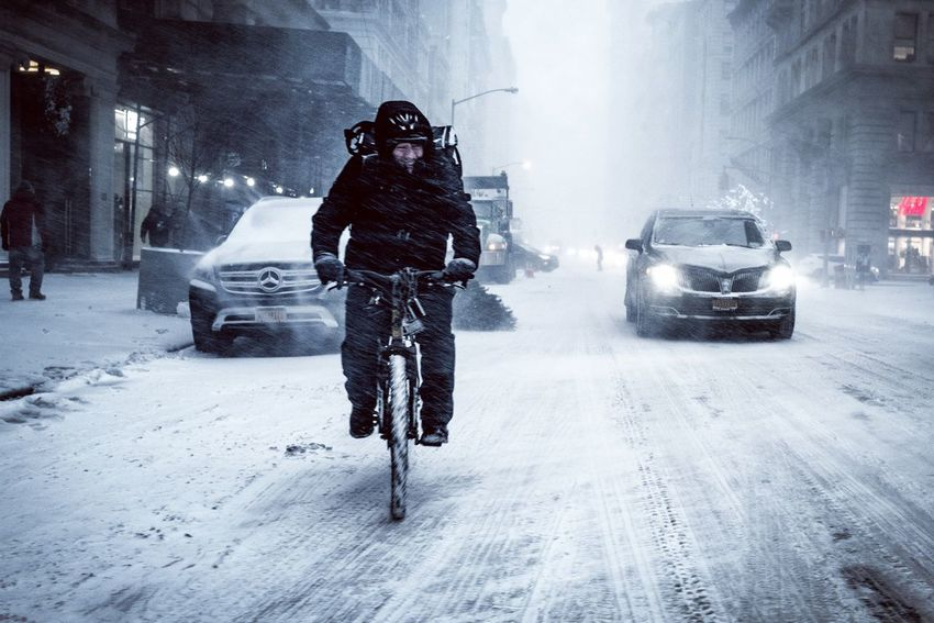 """New York City waking up under the Snowstorm """"Grayson"""" Bombcyclone Sbowstorm Biking Bike Winter Snow Cold Temperature Car Weather Street Snowing Frozen City Street City Life One Man Only Outdoors City"""