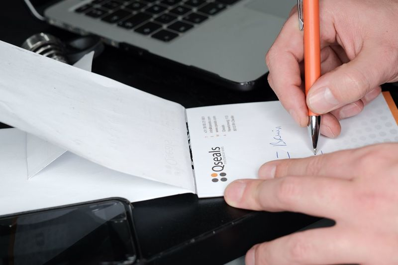 Qseals.com Writing Human Hand Hand Human Body Part One Person Communication Indoors  Real People Paper Holding Text High Angle View Unrecognizable Person Adult Lifestyles