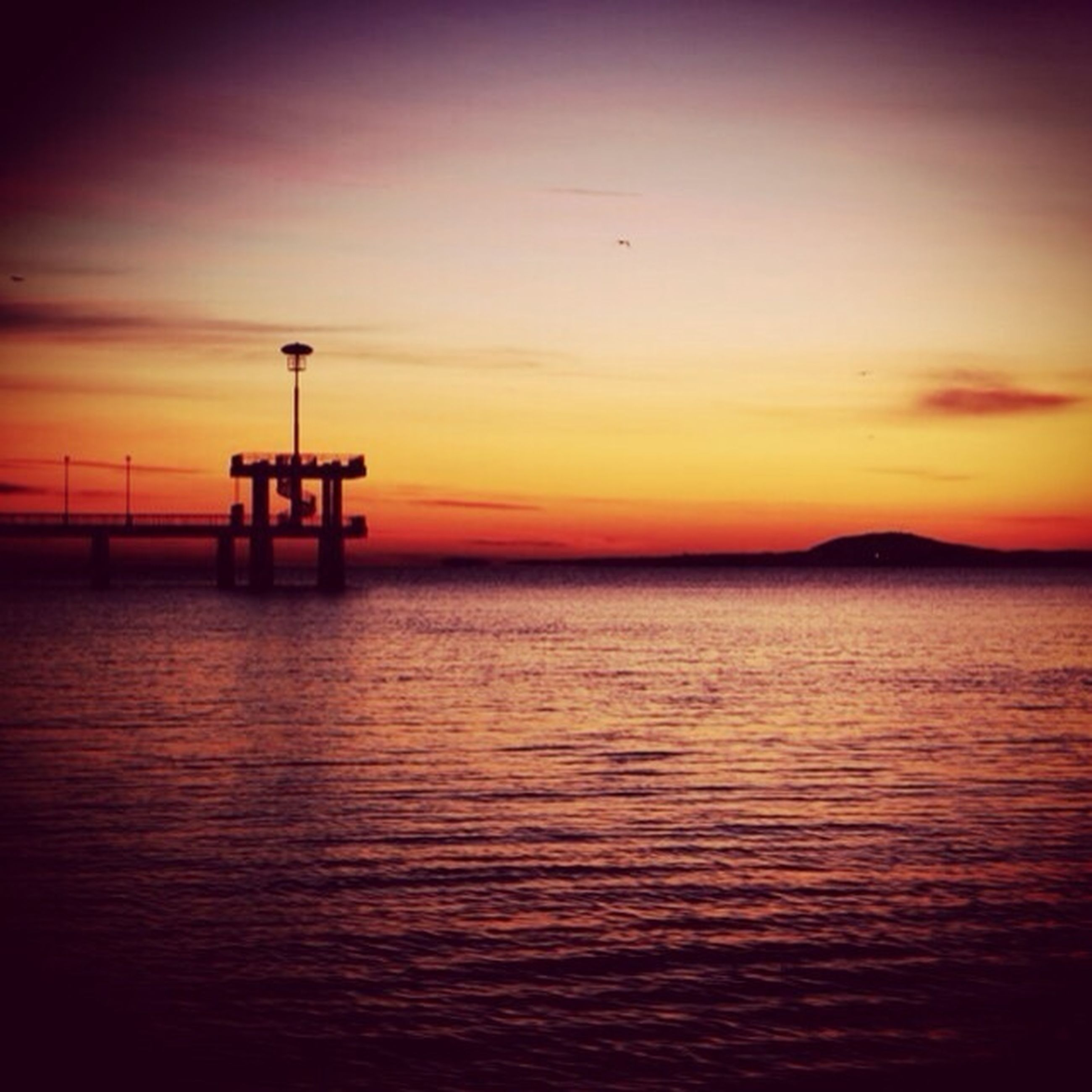 sunset, sea, water, scenics, orange color, tranquil scene, tranquility, sky, beauty in nature, waterfront, horizon over water, silhouette, idyllic, nature, rippled, lighthouse, dusk, ocean, calm, outdoors