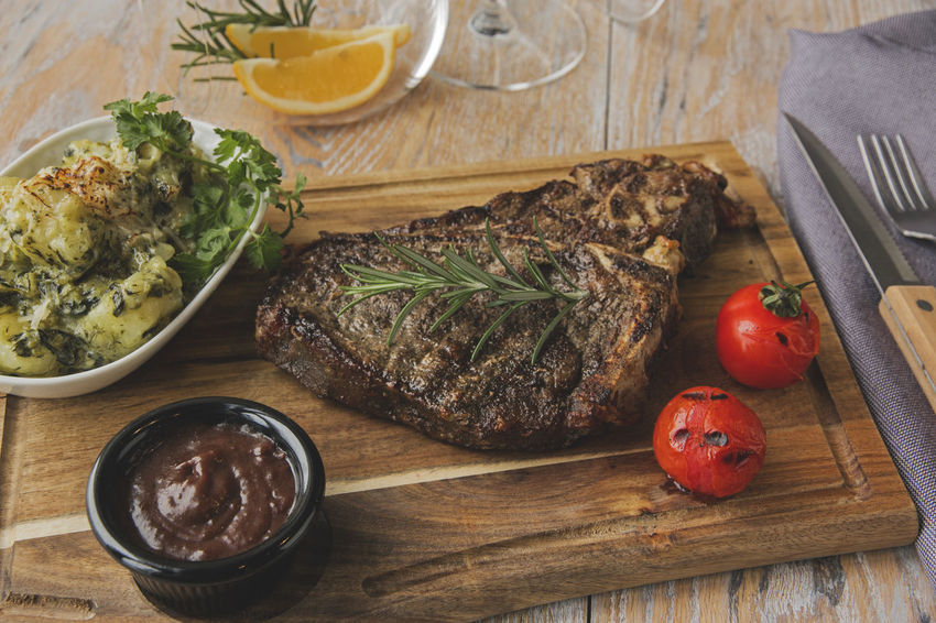 Beef Steak Close-up Day Food Food And Drink Freshness Grilled Healthy Eating High Angle View Indoors  No People Plate Potatoes Ready-to-eat T-bone Table Tomato Wood - Material