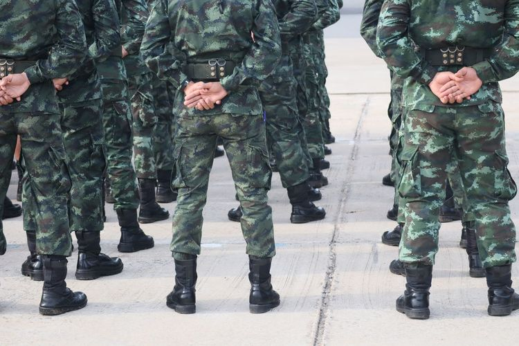 Low section of soldiers standing outdoors