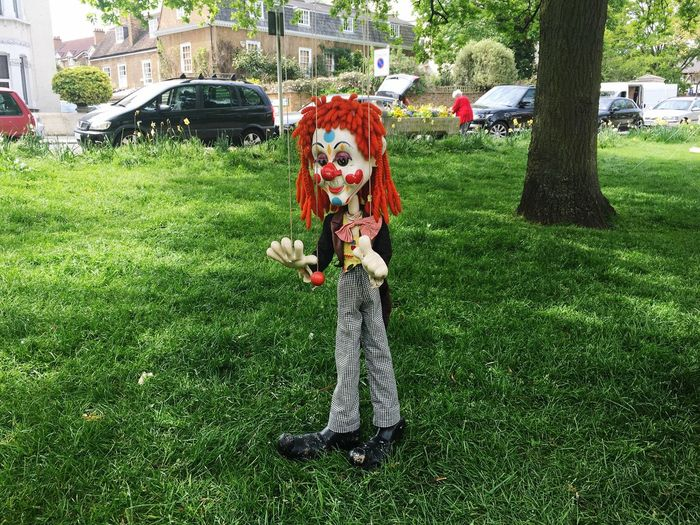 Grass Real People Day Outdoors One Person Green Color Tree Full Length Men Clown Nature Building Exterior Flower People Clown Doll Puppet Love