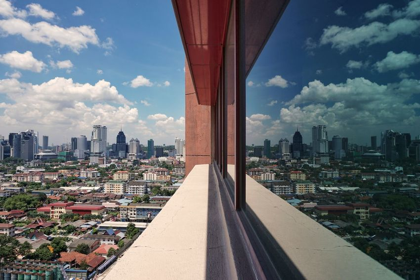 Reflection Window Cityscape City Architecture Skyscraper Urban Skyline Cloud - Sky Bridge - Man Made Structure Business Finance And Industry Sky Modern Downtown District Travel Destinations Outdoors Building Exterior Road Built Structure Day