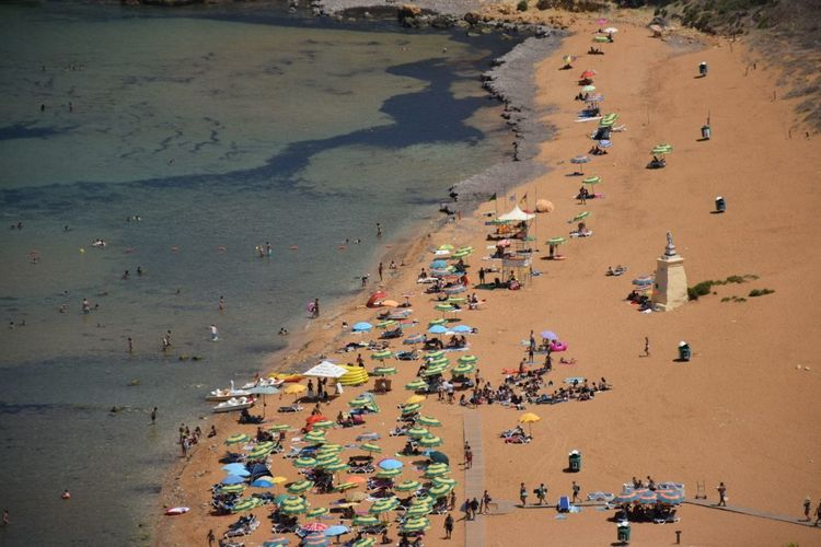 Beach in malta Sand Beach Large Group Of People People Outdoors Landscape Sea Day Crowd Sand Dune Vacations Aerial View Travel Destinations Sunumbrella Colorful Details Overhead View OverviewPoint Viewpoint Nature Water Bay Area