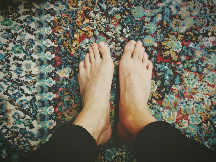 Close-up low section of bare feet