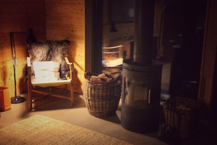 Interior Views Sheepskin Chair Woodburning Stove Fire Room With A View Reading Corner Lamp Logs Baskets Interior Design