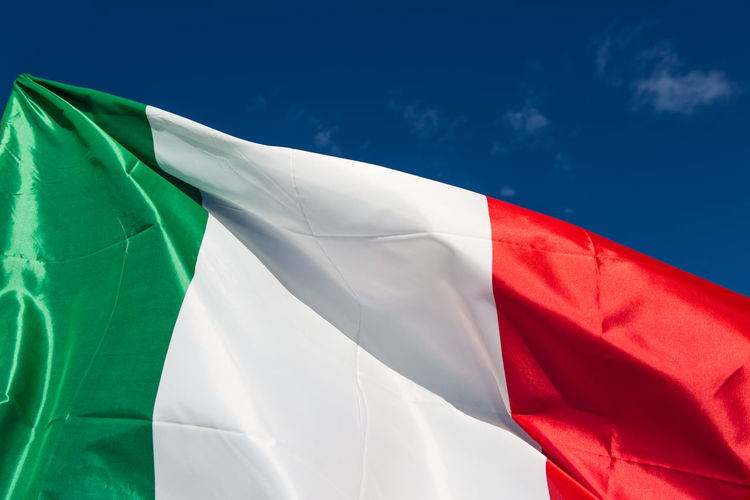 Waving flag of Italy against the blue sky Banner Clouds Country Emblem  Fabric Flag Flags Flags In The Wind  Green Italian Republic Italy Italy❤️ Nation National National Flag No People Patriotic Red Sky State Team Tricolore Waving Waving Flag White First Eyeem Photo