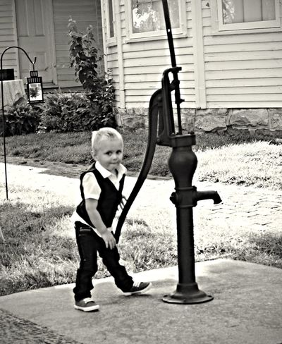 Nephew playing with cast iron water pump Fun Photography Kidsphotography Blackandwhite Summertime
