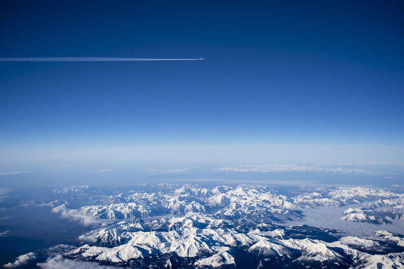 Sky Cloud - Sky Air Vehicle Flying Environment Scenics - Nature Airplane Aerial View Nature Blue Beauty In Nature No People Landscape Copy Space Outdoors Day Snow Vapor Trail Mountain Aerospace Industry Snowcapped Mountain