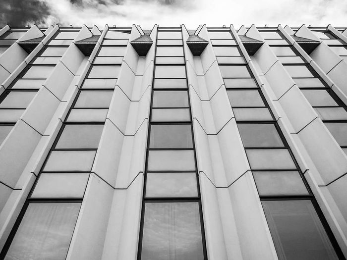 Architecture Building Exterior Low Angle View Built Structure No People Outdoors EyeEm Best Shots - Black + White EyeEm Gallery EyeEm Best Shots Eyeemphotography Architecture Contrast Monochrome Black And White Graphic Glass Glass Reflection Window Wall - Building Feature Repetition Building Feature Pattern Fine Art Photography Minimalism