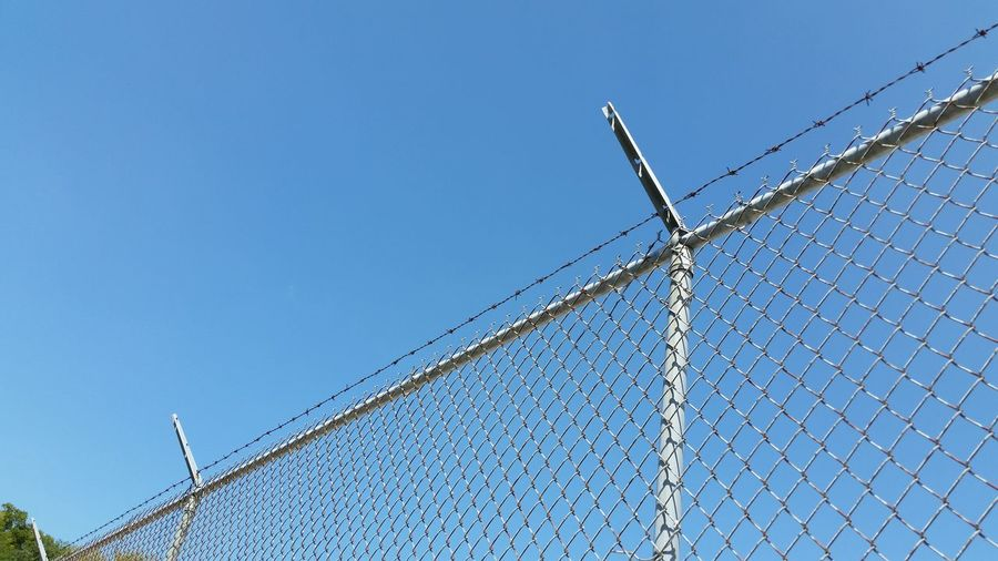 Low Angle View Of Fence