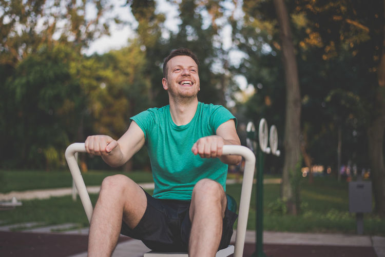 Man sitting on seat in park