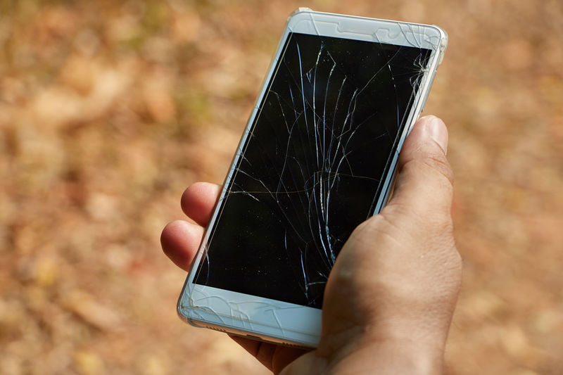 Broken screen : Screen Broken Cracked Human Hand Hand Human Body Part Technology Real People Holding One Person Wireless Technology Portable Information Device Focus On Foreground Communication Smart Phone Mobile Phone Leisure Activity Body Part Unrecognizable Person Lifestyles Close-up Touch Screen Outdoors Finger