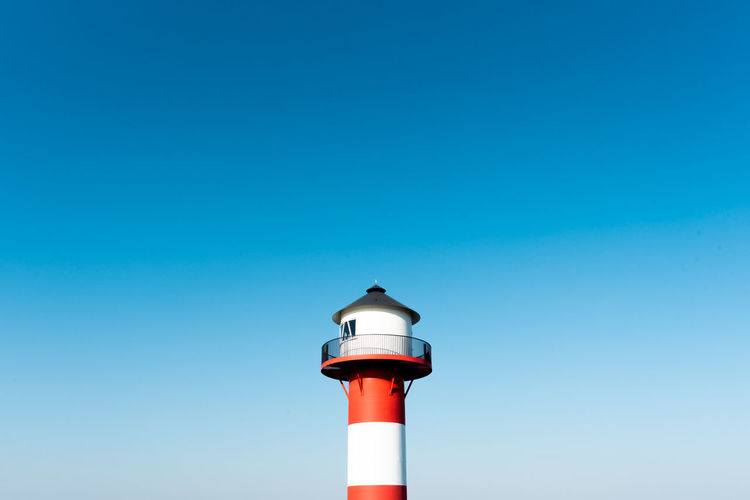 seaside minimalism Lighthouse Lighthouse_lovers Lühe Building Exterior Stripes Stripes Pattern Red And White Nautical Nautical Equipment Harbor Harbour Seaside Sky Clear Sky Blue Sky Minimalism Sea And Sky From The Dyke Lighting Equipment Navigation Architecture Tower Sea Life Direction Guidance Navigational Equipment Spring Springtime Norddeutschland Germany German Daylight Day Scenics Seascape Safety The Way Forward High Angle View Non-urban Scene Countryside Minimalist Architecture Niedersachsen Protection Traffic Traffic Signal Signal Round Shape Building Landscape Open Edit