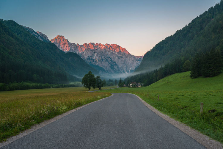 Logarska valley at dawn Beauty In Nature Country Road Countryside Dawn Diminishing Perspective Empty Empty Road Grass Idyllic Landscape Mountain The 00 Mission Nature Nature Non-urban Scene Photography Remote Road Scenics Sky Slovenia Summer Sunrise Tranquility Tree