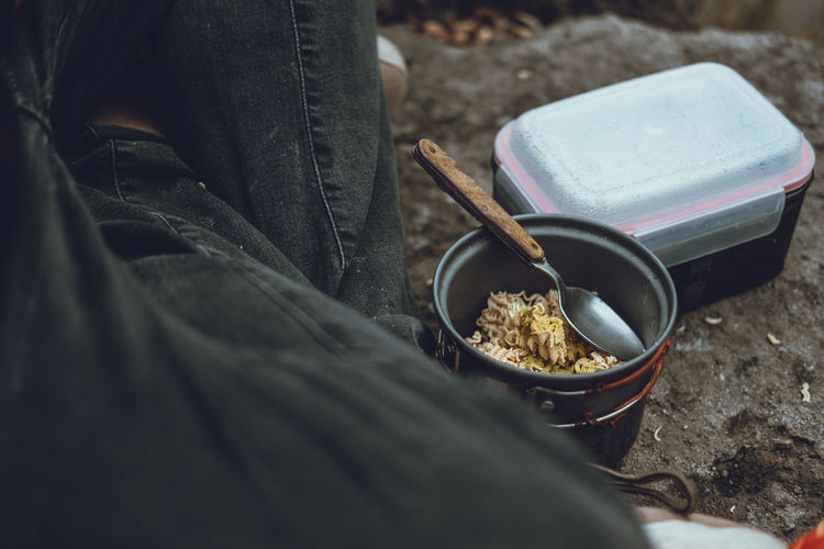 Hiking Meal Noodles Close-up Day Food Food And Drink Freshness Human Body Part Human Hand Lifestyles Low Section Noodlesoup One Person Outdoors People Real People