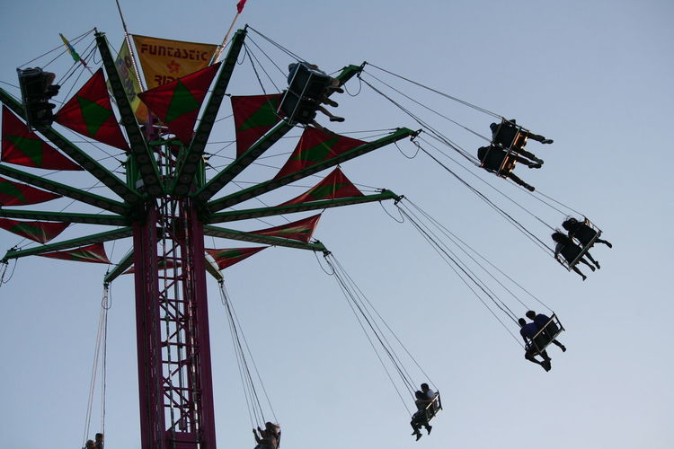 Low angle view of chain swing ride