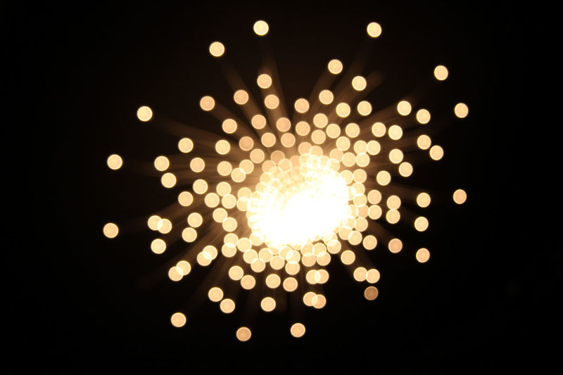 Blurred Arts Culture And Entertainment Black Background Chandelier Circle Close-up Decoration Defocused Enlightened Illuminated Lamp Landscape Light In The Darkness Lights In The Dark Night No People Outdoors Sky Stars Yellow