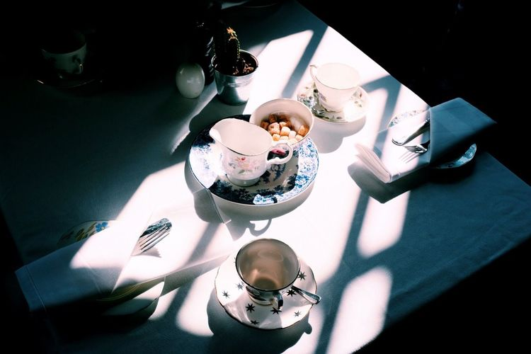 Tea for two | High Angle View Tea Tea - Hot Drink Indoors  Table Sunlight Sunlight And Shadow Table Setting Long Goodbye Eyeemphotography Eye4photography  EyeEm Gallery Taking Photos Light And Shadow Minimalism Creative Light And Shadow BYOPaper!
