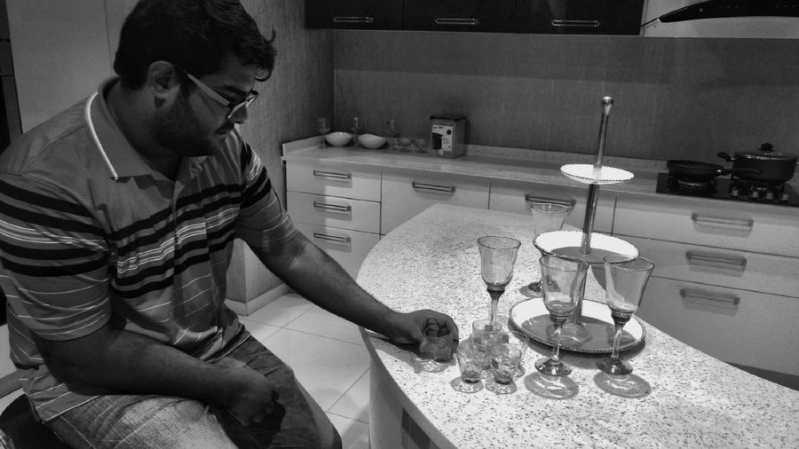 Deep thoughts One Person Kitchen Indoors  Domestic Life Lifestyles One Man Only Adults Only Only Men Food Service Occupation Mobilephotography Motog4plus Eye4photography  EyeEm Best Shots Black And White Collection  Domestic Room Domestic Kitchen Archival Chores
