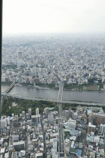 Aerial view of cityscape and river