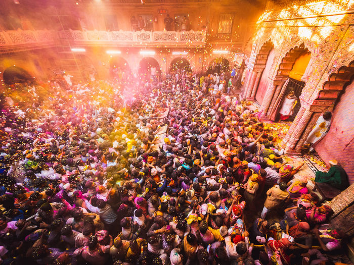 Holi festivities in one of the craziest temple ceremonies I have ever seen. Banke Bihara sees thousands of wild Indians and tourists party with flurriess of colour. Crowd Group Of People Large Group Of People Real People Architecture Built Structure Men Illuminated Women Building Exterior Adult Lifestyles Outdoors Leisure Activity Celebration City Travel Destinations Day Enjoyment Architectural Column Excitement Spectator India Vrindavan Banke Bihara Temple Party Festival Holi Holi Festival Powder Olympus Week On Eyeem Temple Religion High Angle View Hinduism
