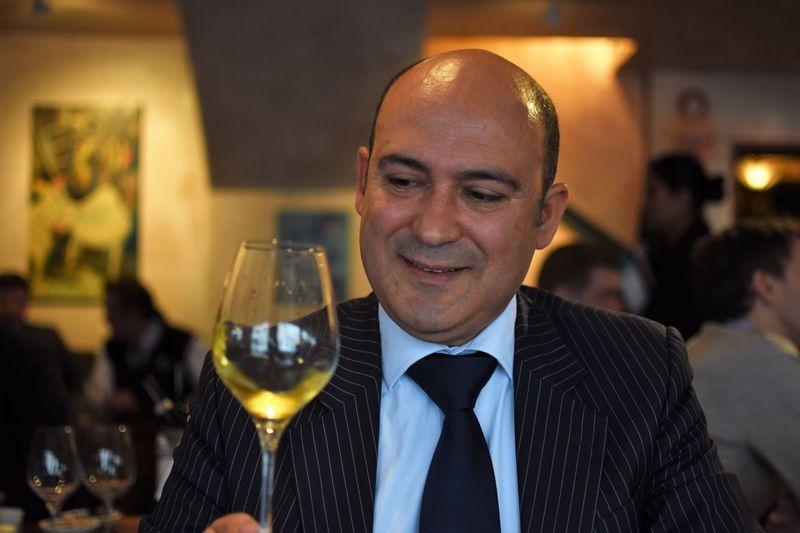 Close-Up Of Businessman Having Wine At Restaurant
