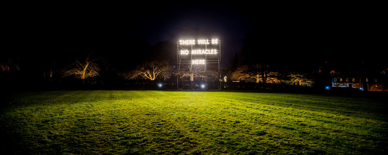 "Panoramic photo of Nathan Coley's light sculpture installation ""There Will Be No Miracles Here"" Art Installation Edinburgh Light Nathan Coley Scotland There Will Be No Miracles Here Art Illuminated Night No People Sculpture"