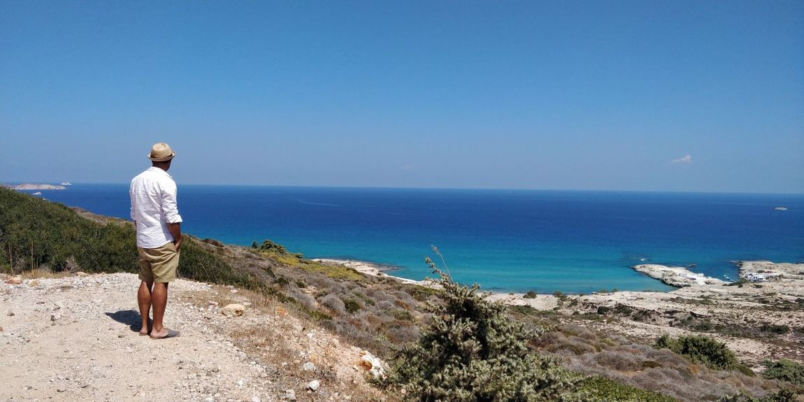 OnePlus 5t 3XSPUnity Greece île De Milos EyeEm Selects Sea Full Length Beach Water Standing Politics And Government Women Blue Rear View Sky Looking At View Human Back Observation Point Coast Countryside Scenics Tranquil Scene Horizon Over Water Non-urban Scene Idyllic Rocky Mountains