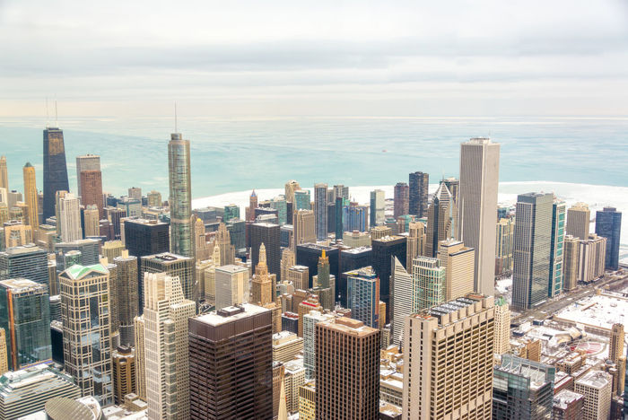 Skyscrapers of downtown Chicago with frozen Lake Michigan visible in the background Architecture Building Building Exterior Buildings Built Structure Chicago Chicago Architecture City Cityscape Colorful Destination Downtown Downtown Chicago Frozen Hancock HancockTower Horizon Illinois Lake Landmark Modern Office Building Outdoors Panoramic Winter