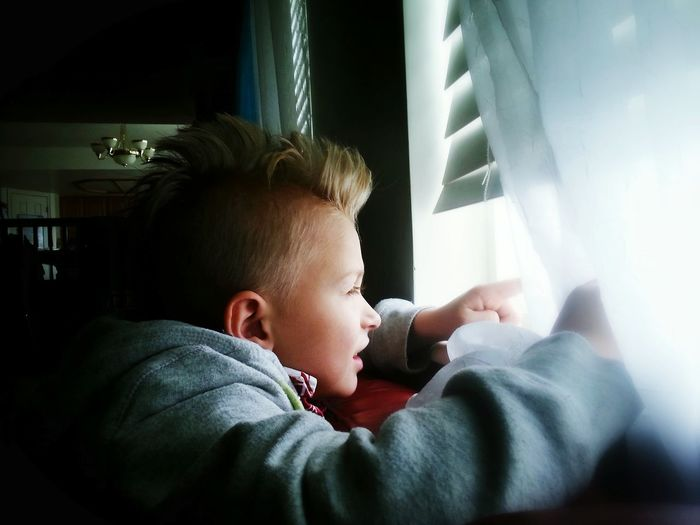 Watching the storm. Stormy Weather Window Looking Out Of The Window Natural Light Window Light Thunderstorm Boy Child Real Moments Smartphone Photography Our House Kid Home Interior Portrait Childhood