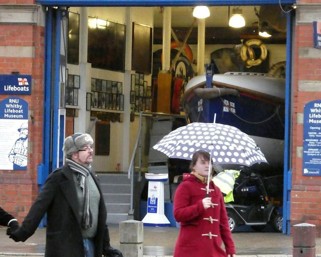 Waiting Game Lifeboat Museum Steps Eyemschool Boat Signs Real People People And Places Boathouse Charitywork Rainy Season Women Warm Clothing Spot Pattern Umbrella Red Coat Fur Hat