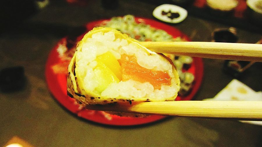 Close-Up Of California Roll With Chopsticks