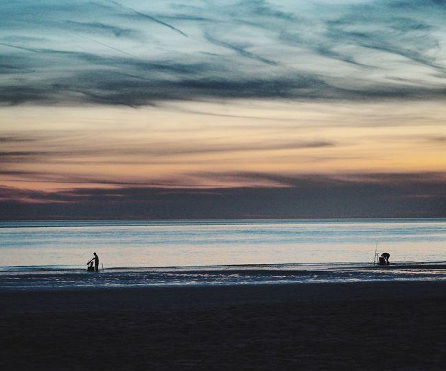 Sunset Sunset Silhouettes Fishermen Sea And Sky Horizon Over Water Horizontal Symmetry